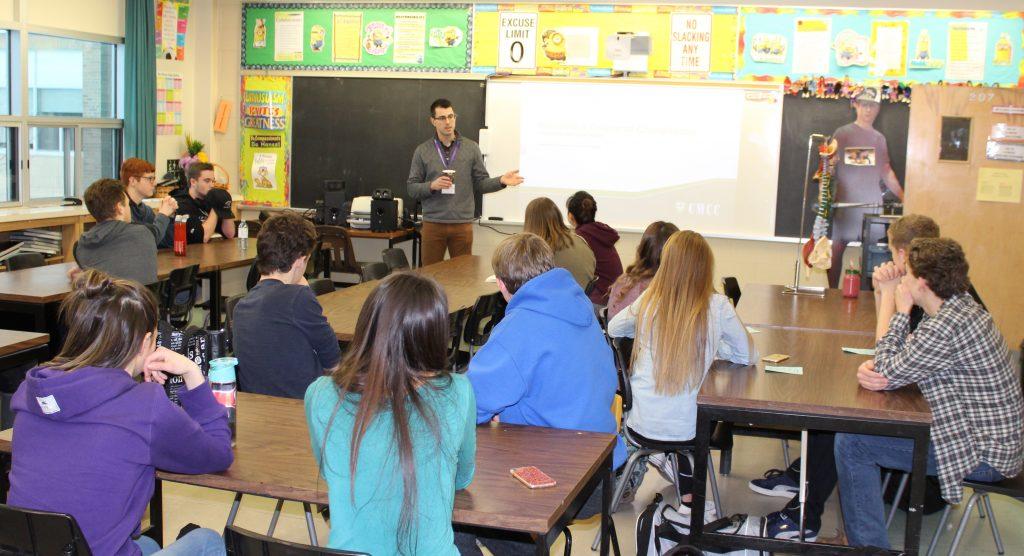 Man talk to students.